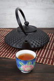 Traditional Japanese cast iron teapot with teacup. Royalty Free Stock Photo