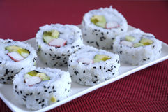 Traditional Japanese Cuisine. Cucumber maki sushi with sesame seeds Stock Photo