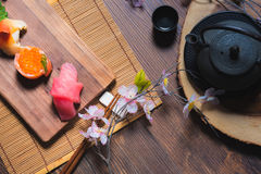 Traditional Japanese cuisine. Process of eating sushi rolls or s. Ushi set with salmon, selective focus Stock Photography
