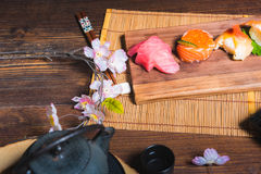 Traditional Japanese cuisine. Process of eating sushi rolls or s. Ushi set with salmon, selective focus Royalty Free Stock Photography