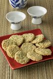 Japanese cups with sake and seaweed rice crackers stock photos
