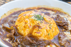 Traditional Japanese curry omelet rice with beef Royalty Free Stock Images