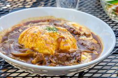 Traditional Japanese curry omelet rice with beef Stock Photography