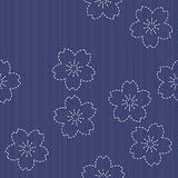 Traditional Japanese Embroidery Ornament with blooming sakura flowers. Royalty Free Stock Photo