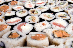 Traditional Japanese food. Collection of different rolls served on the round plate royalty free stock photography
