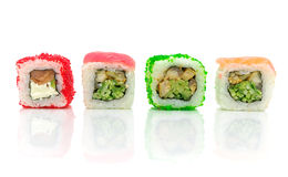 Traditional Japanese food. Different rolls on a white background Royalty Free Stock Image