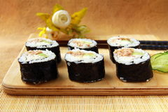 Traditional Japanese food maki rolls. On a wooden board royalty free stock photography