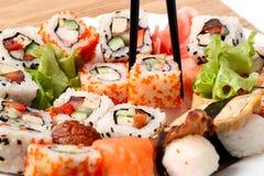 Traditional Japanese food Sushi. Closeup japanese sushi on a bamboo napkin. Sushi collection Stock Image