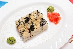 Traditional Japanese food Sushi. Closeup japanese sushi on a whi Stock Photo