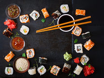 Traditional Japanese food - sushi, rolls and sauce on a dark background. Stock Image