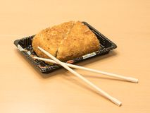 Traditional Japanese food - sushi toast, cut into four pieces with  wooden chopsticks on a tray. Traditional Japanese food - sushi toast, cut into four pieces Royalty Free Stock Photos