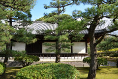 Traditional Japanese Garden and Building. Pristine traditional Japanese garden and picturesque building Stock Photos