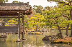 Traditional Japanese Garden In The Rain. A traditional Japanese garden in the rain in Kyoto, Japan Royalty Free Stock Photos