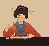 Traditional japanese girl enjoy sushi Stock Photos