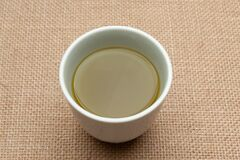 Traditional Japanese green tea isolated on jute background. Close-up. Top view