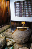 Traditional Japanese home style with bamboo fountain Royalty Free Stock Photo
