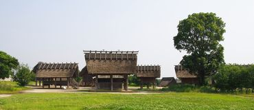 Traditional Japanese Houses in Yoshinogari Historical Park. In Japan. The park covers the remains of ancient Yayoi period 300 BC to 300 AD moat-encircled Royalty Free Stock Photography