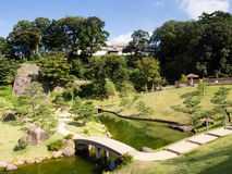 Traditional Japanese landscape garden on the grounds of Kanazawa castle Stock Photography