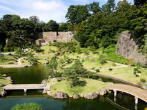 Traditional Japanese landscape garden on the grounds of Kanazawa castle Royalty Free Stock Photo