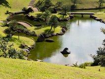 Traditional Japanese landscape garden on the grounds of Kanazawa castle Stock Images