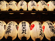 Traditional Japanese lanterns. View of brightly lit Japanese paper lanterns hung high above from below stock images