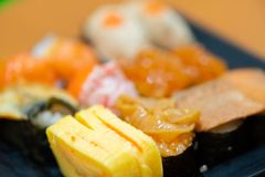Traditional japanese local food sushi.delicious seafood sushi with wasabi and seaweed on black plate.japanese chef cook sushi for. Customer at japanese stock images