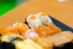 Traditional japanese local food sushi.delicious seafood sushi with wasabi and seaweed on black plate.japanese chef cook sushi for. Customer at japanese royalty free stock photo