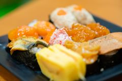 Traditional japanese local food sushi.delicious seafood sushi with wasabi and seaweed on black plate.japanese chef cook sushi for. Customer at japanese stock photography