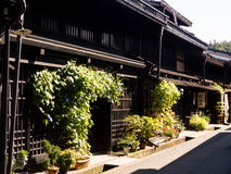 Traditional Japanese merchant house. Takayama, Japan - October 6, 2015: Preserved street with Edo era merchant houses in Sannomachi historic district Royalty Free Stock Photos