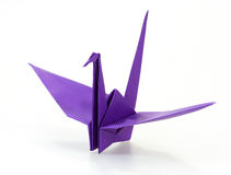 Traditional Japanese origami crane made of purple paper Stock Images