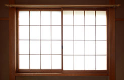 Traditional Japanese rice paper window with sliding wooden frame Royalty Free Stock Images