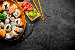 Traditional Japanese rolls and sushi in a plate on a stone Board stock photos