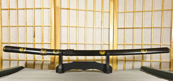 Traditional Japanese samurai sword. Mounted on special black wooden stand Stock Photography