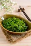 Traditional Japanese seaweed salad with chopsticks Royalty Free Stock Photos