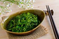 Traditional Japanese seaweed salad with chopsticks Stock Image