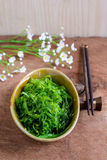 Traditional Japanese seaweed salad with chopsticks Royalty Free Stock Image