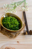 Traditional Japanese seaweed salad with chopsticks Royalty Free Stock Photography