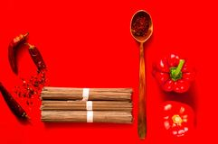 Traditional japanese soba noodles and ingredients on creative red background, concept of asian food and healthy diet. stock photos