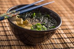 Traditional japanese soup Miso with tofu seaweed chopsticks and. Young onion stock photo