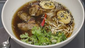 Traditional Japanese soup ramen with meat broth, asian noodles, seaweed, sliced chiken, eggs. Close up. Asian style food