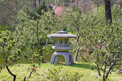 Traditional Japanese stone lantern in Japanese garden Stock Photography