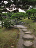 Traditional Japanese stroll garden with stepping stone pathway Royalty Free Stock Image
