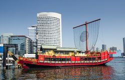 Traditional japanese style red boat at Tokyo bay. TOKYO, JAPAN - MARCH 24, 2014: Traditional japanese style red boat at Tokyo bay royalty free stock photo