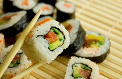 Traditional japanese sushi on bamboo napkin Royalty Free Stock Photos