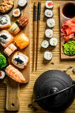 Traditional Japanese sushi, maki and rolls on a napkin. On rustic background royalty free stock photo