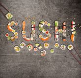 Traditional japanese sushi pieces making inscription. Royalty Free Stock Photography