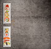 Traditional japanese sushi pieces on rustic concrete background. stock photography