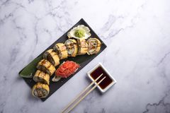 Traditional japanese sushi rolled in egg with soy souce stock photos