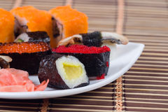 Traditional japanese sushi and rolls royalty free stock photo
