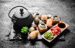 Traditional Japanese sushi rolls with green tea royalty free stock photos